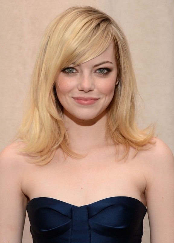 emma stone medium straight hairstyle with side swept bangs | hair