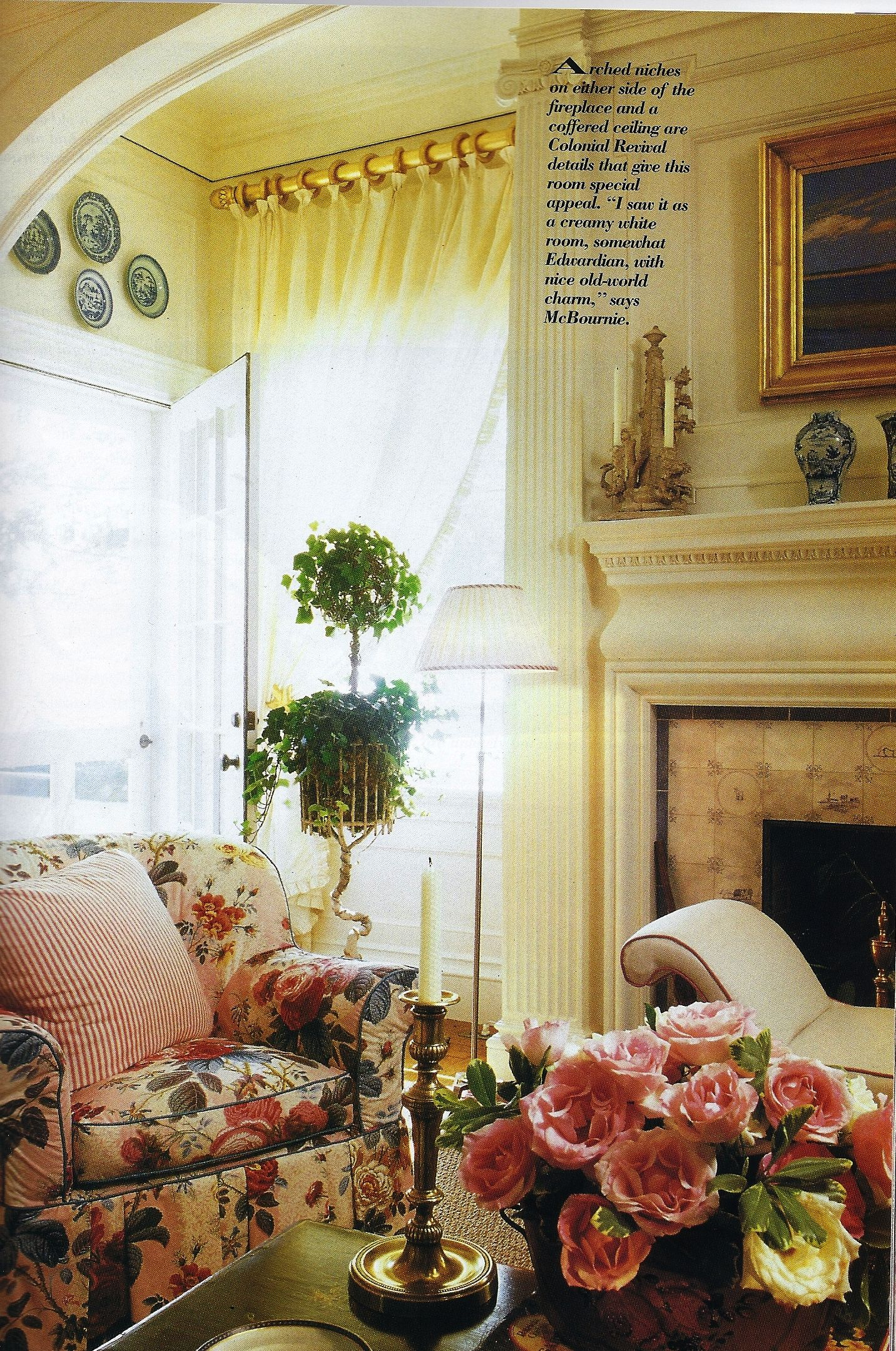 English room with a chintz chair, ivy topiary, plates on ...