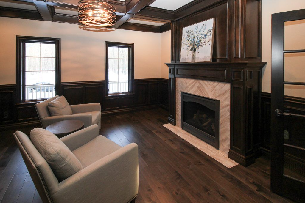 Dark Maple Hardwood Flooring And Beige Tiled Family Room Fireplace Cozy Living Spaces Family Room Fireplace Maple Hardwood Floors