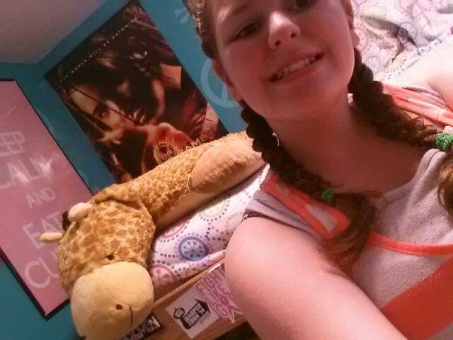 Got a hair cut! These braids make me look 6! :p. Melmen the giraffe in the background.