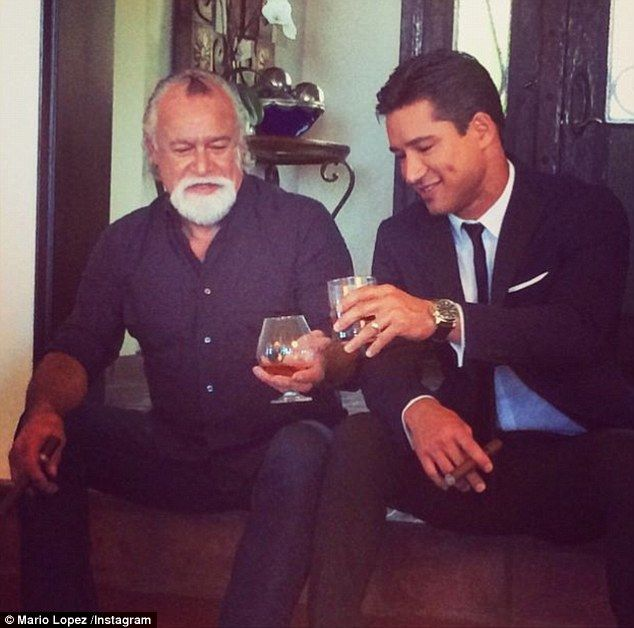 Mario Lopez Smokes A Cigar While Holding His Son On The 4th Of