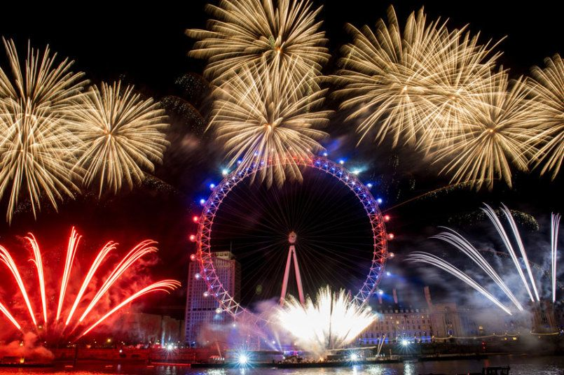 Fireworks are set off by the London Eye in London for New Year 2016.