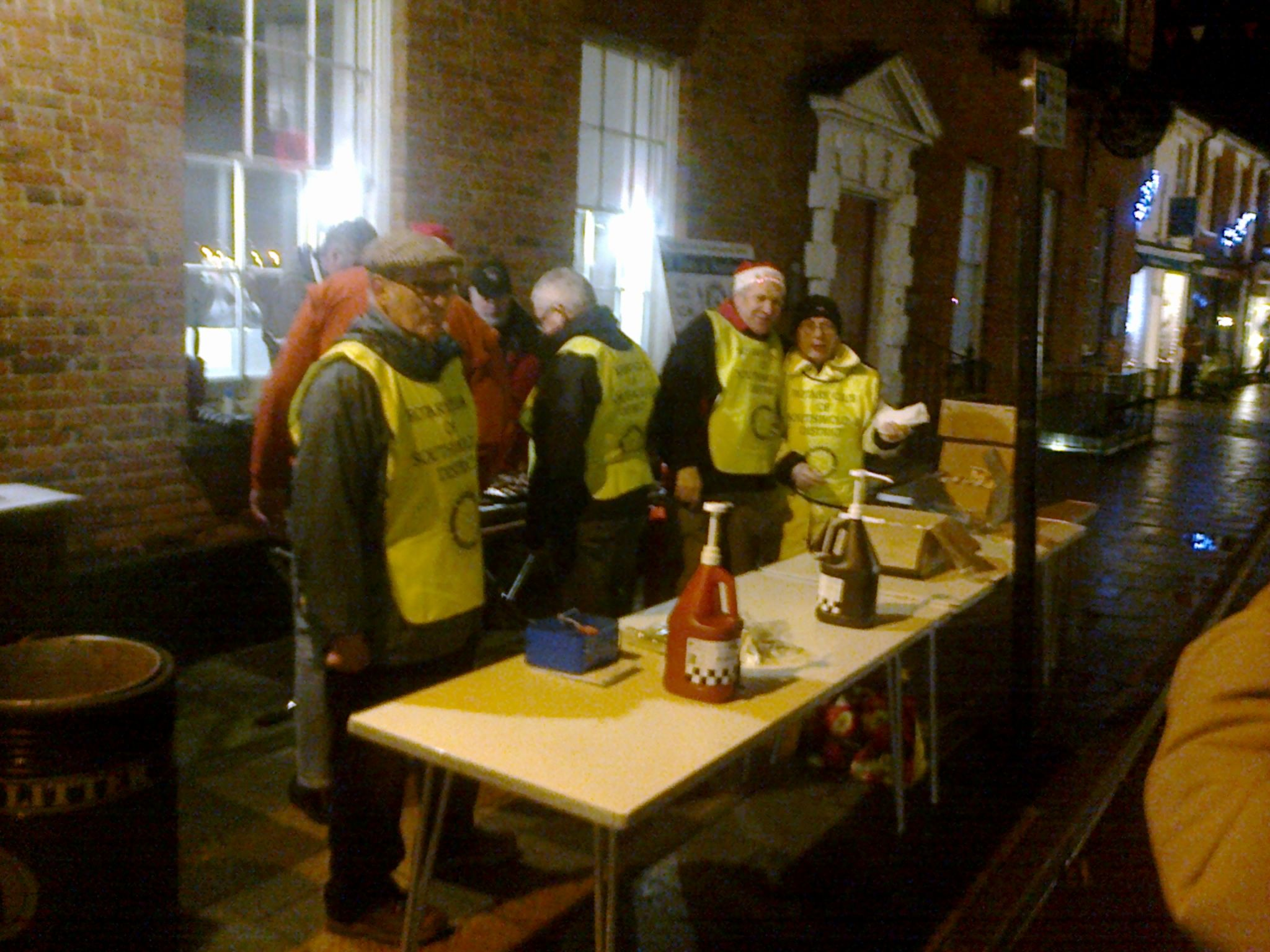 Rotarians cook hot dogs at Christmas Lights switch-on. Southwold.