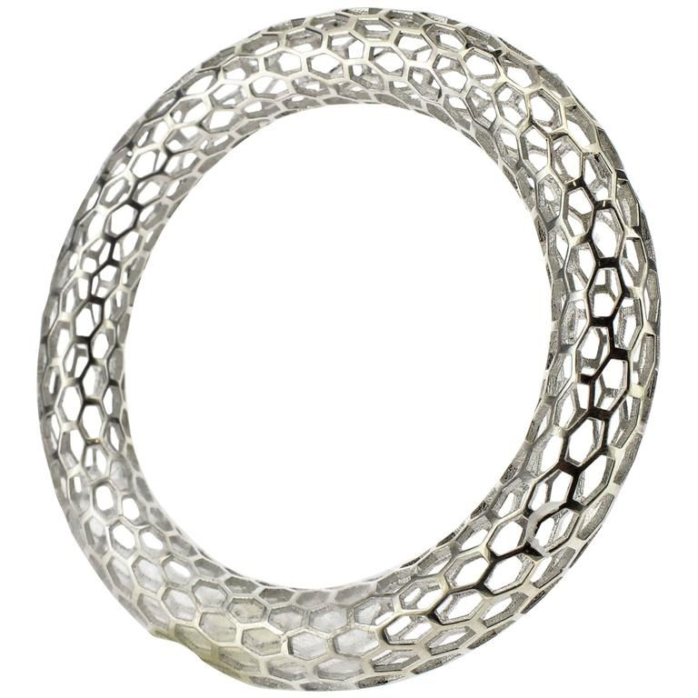 Islet Narrow Bangle Bracelet in Sterling Silver by Doug Bucci, 2016   From a unique collection of antique and modern miscellaneous jewelry at https://www.1stdibs.com/furniture/more-furniture-collectibles/miscellaneous-jewelry/