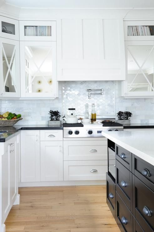 Beautiful Black And White Kitchen Features Mirrored Upper Cabinets