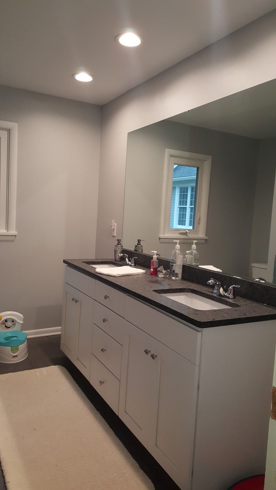 After bathroom remodel sherwin williams gray screen paint granite countertop 3 recessed lights above the vanity double sinks chrome fixtures
