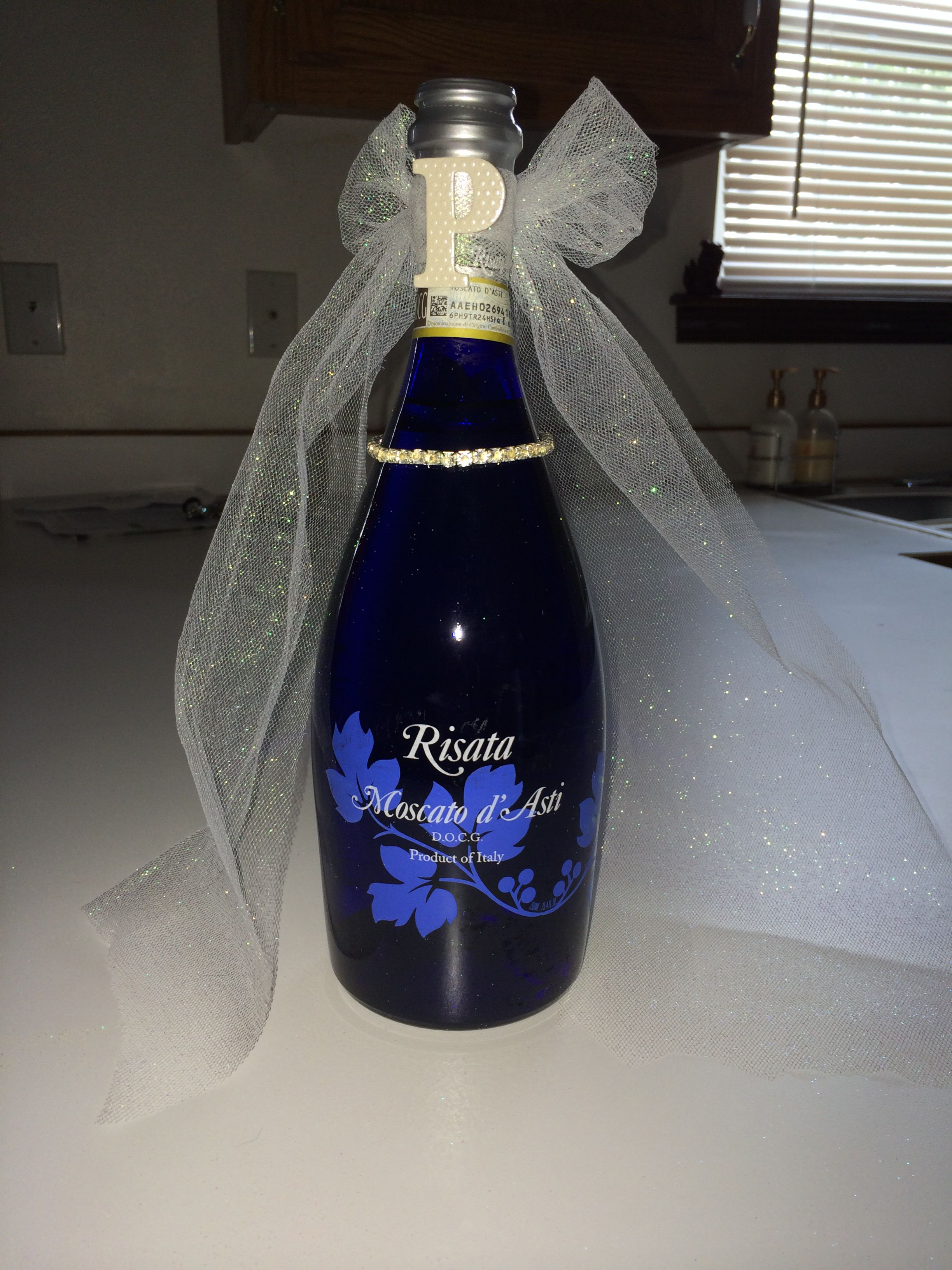 decorated bride wine bottle as wedding shower gift tied