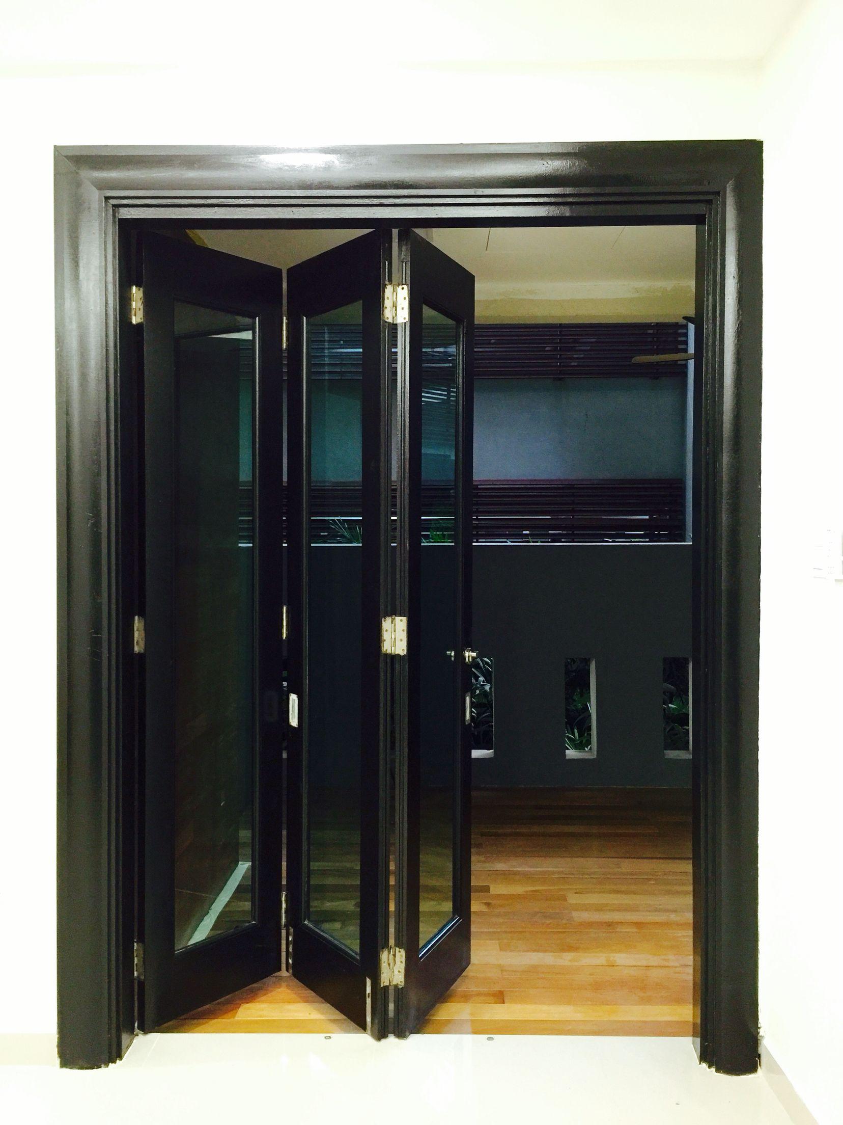 BACKYARD AREA, folding door c/w architrave black matte painted color ...
