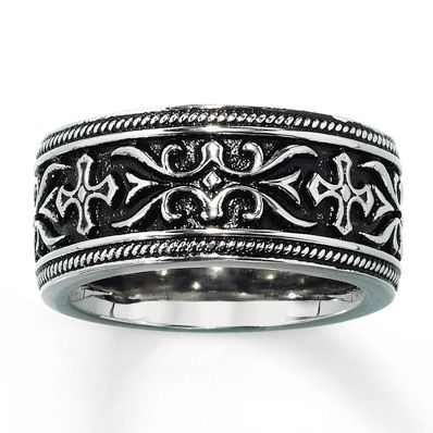 A bold design of crosses and a scroll pattern demands attention in this dramatic wedding band for him. This ring is crafted in stainless steel.