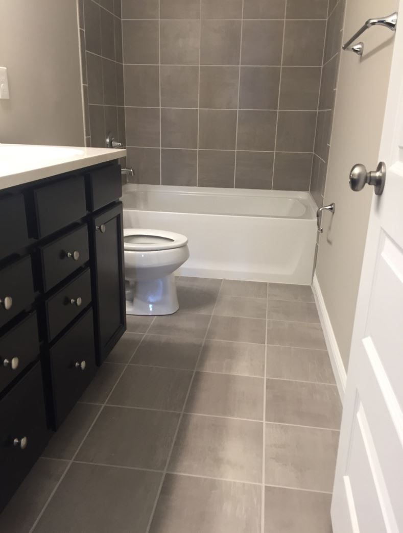 Skybridge Gray 12x12 Tile Installed Brick Joint On Floor And Walls Tile Bathroom Bathroom Wall Tile Basement Bathroom Remodeling