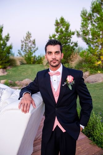 Navy blue suit with pink bow tie and vest. Celebrity Tux