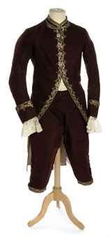 A GENTLEMAN'S COAT AND BREECHES OF PLUM COLOURED CISELÉ VELVET  1760S, PROBABLY FRENCH  with elegantly embroidered guilloche borders in silver and green