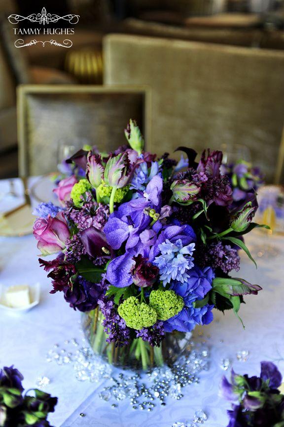 purples, greens centerpiece by Michael Hernandez