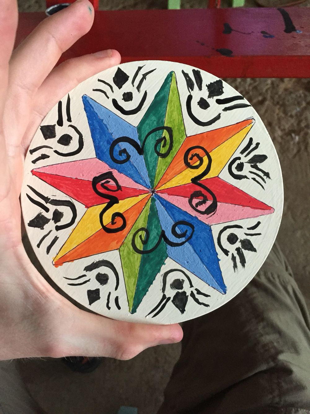 End result, a beautifully painted small ox cart wheel