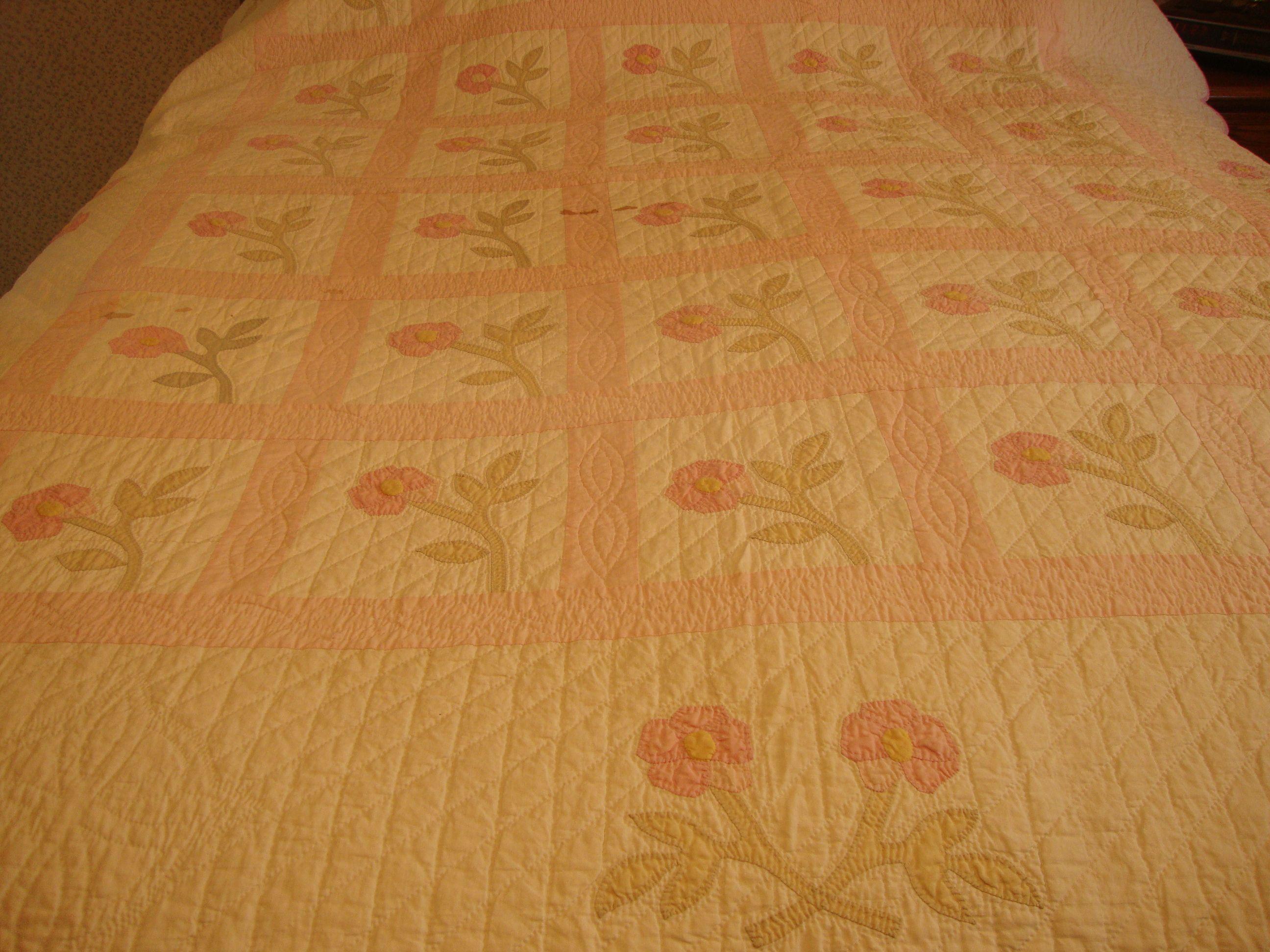 Closer look at antique wild rose quilt.