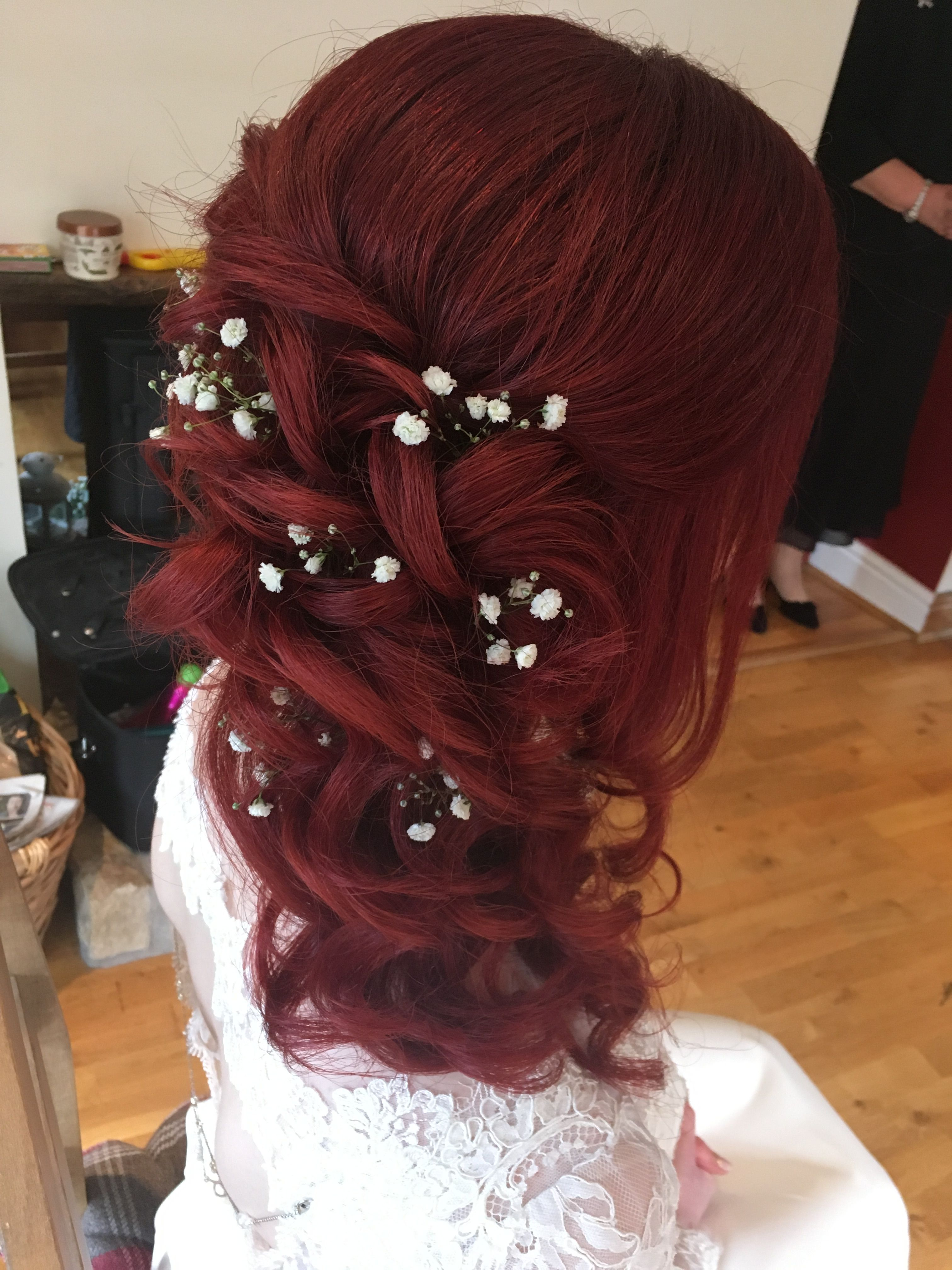 red hair curled one side hair style with gypsophila | hair