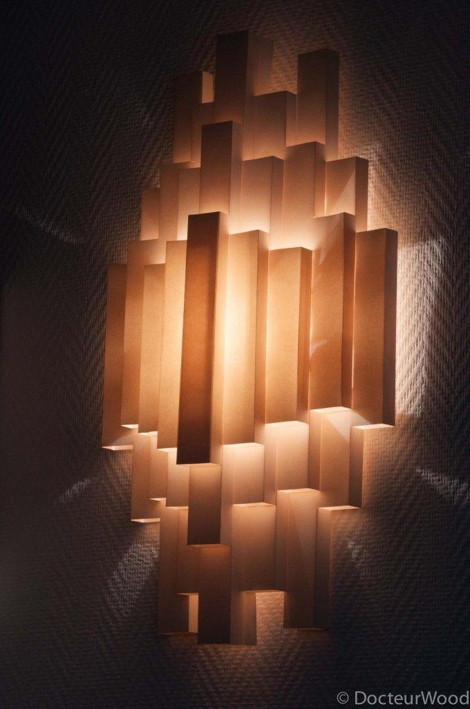 applique murale inspirée par un luminaire d un designer