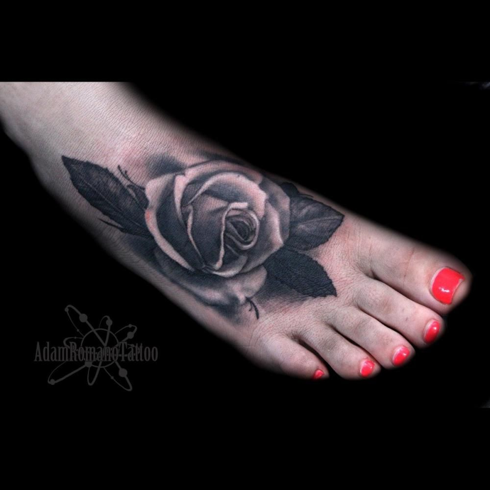 The traditional red rose tattoo symbolizes love and passion. A pink rose represents grace, gratitude, and affection while purple roses have been used to symbolize royalty and enchantment. #AdamRomano #TattooAwards #TattooIdeas #LegTattoos #RealismTattoos #RoseTattoos