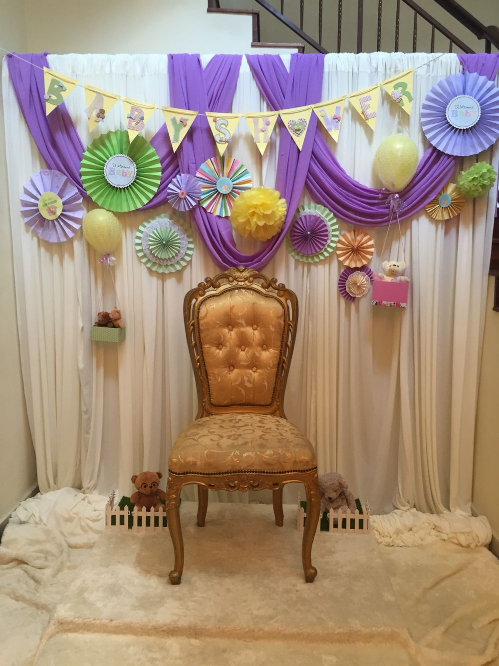 Backdrop Where The Mom To Be Sits All The Guests Put Bangles For