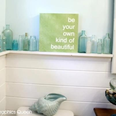 Love the bottles. sea foam bathroom