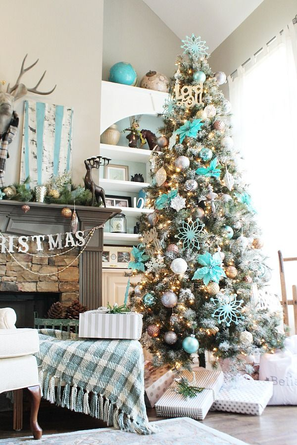 christmas tree fresh winter snow scene with birch trees on the mantle and the tree is a turquoise winter wonderland idea