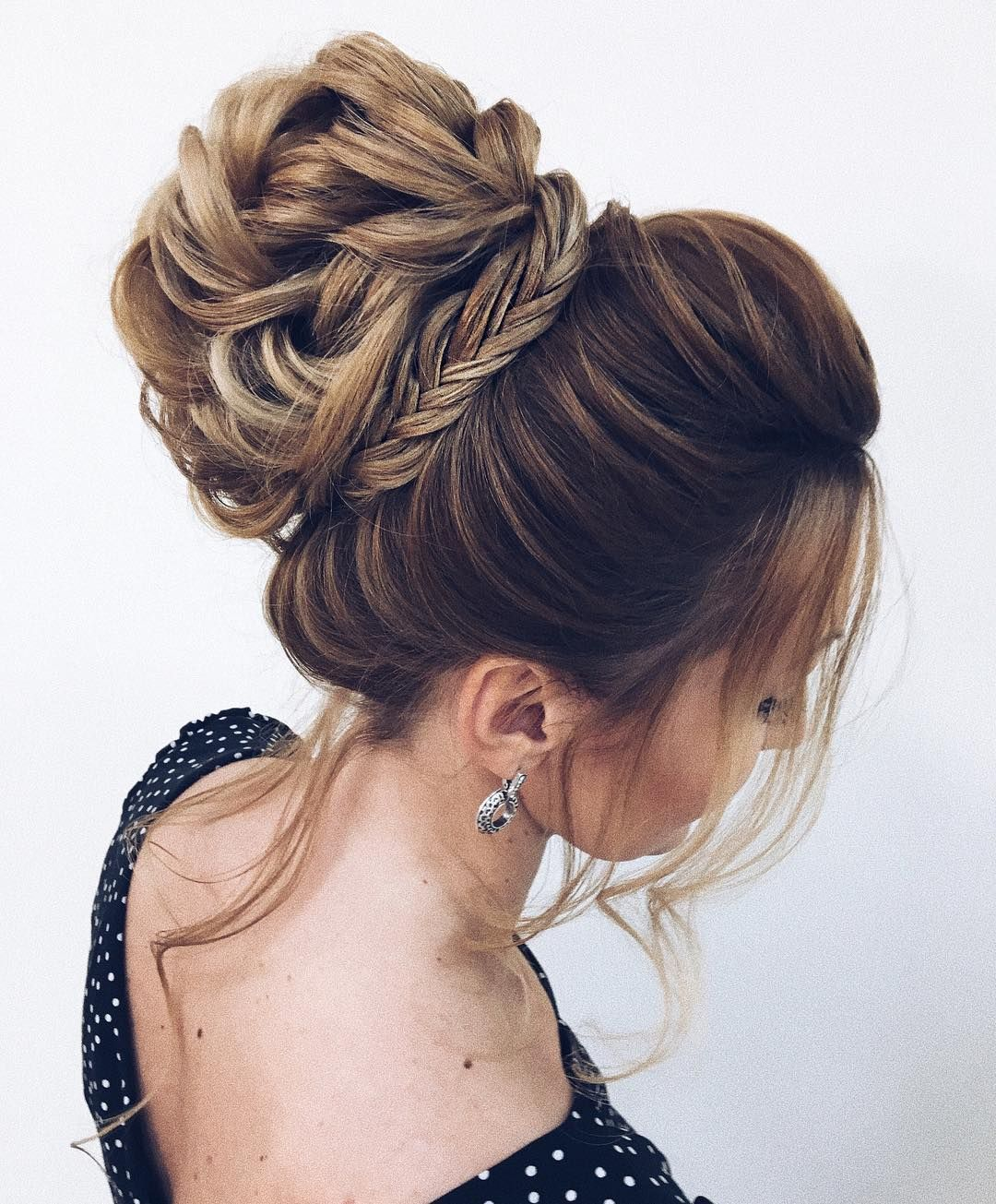 unique updo hairstyle , high bun hairstyle ,prom hairstyles
