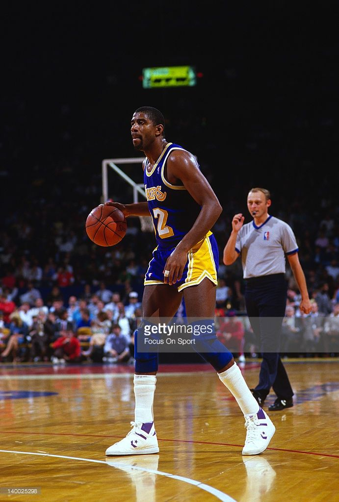 85c9380e0a2a Earvin Magic Johnson  32 of the Los Angeles Lakers dribbles the ball up  court against the Washington Bullets during an NBA basketball game circa  1984 at the ...