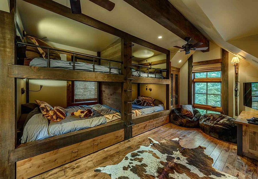 rustic guest bedroom with carpet exposed beam wall sconce