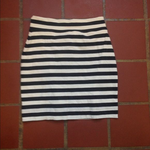 Moda international striped mini skirt Mini skirt black and white striped. Only worn once. Like new. Moda International Skirts Mini