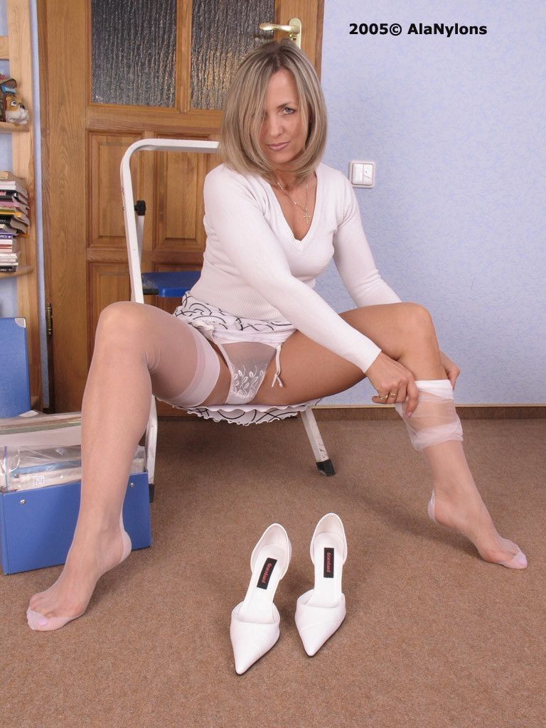 Milf shows off feet and stockings