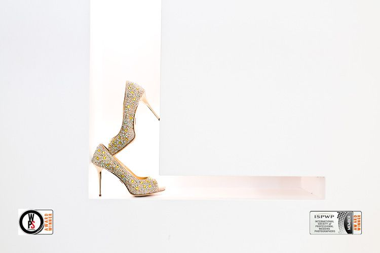 This picture of Jana's wedding shoes won an ISPWP and WPS Award. It was taken while a getting ready at Marlies Möller Neuer Wall Hamburg by orange-foto wedding photographer