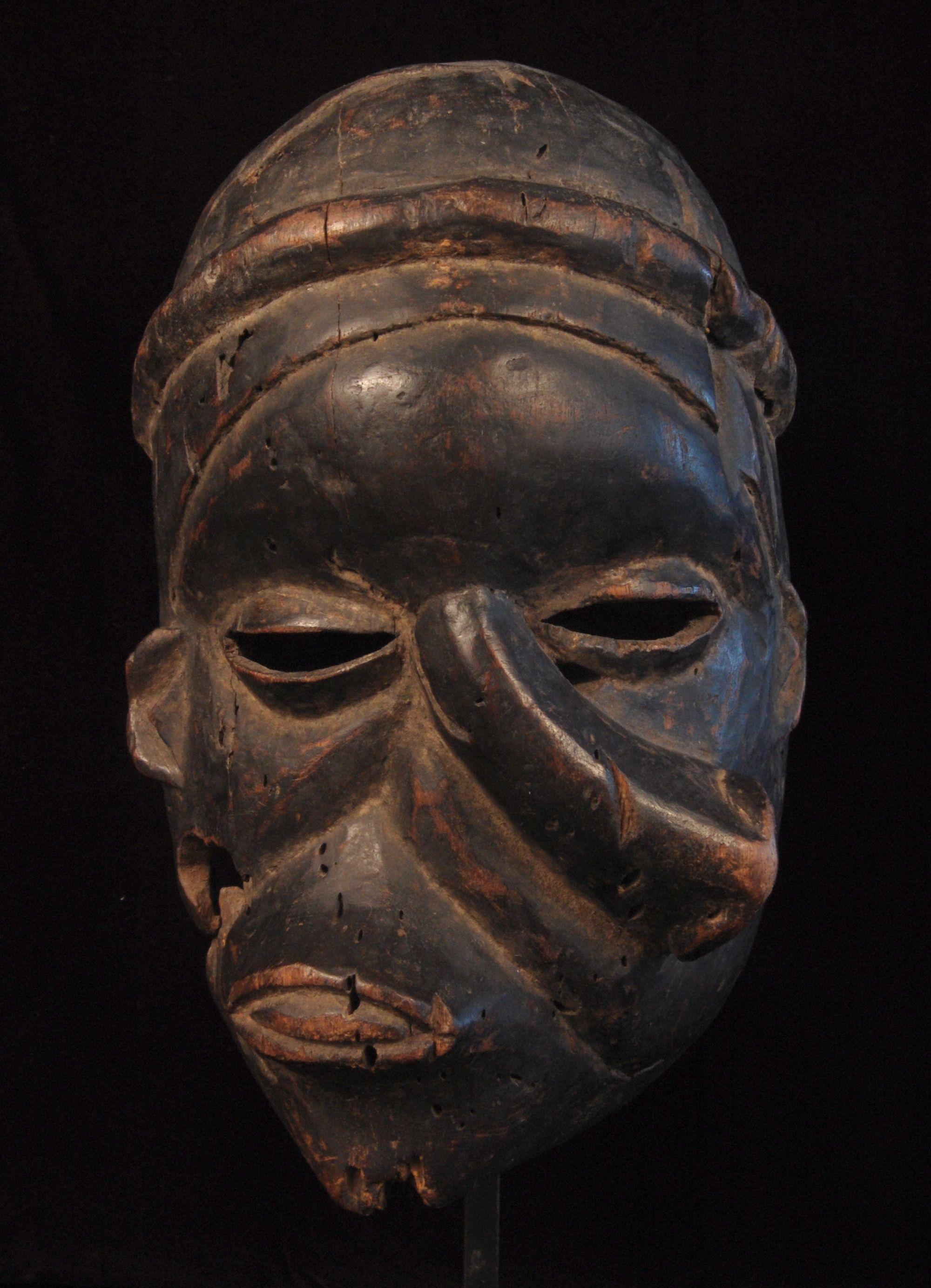 Ibibio Deformation Mask,  Nigeria  Height: 11 inches.