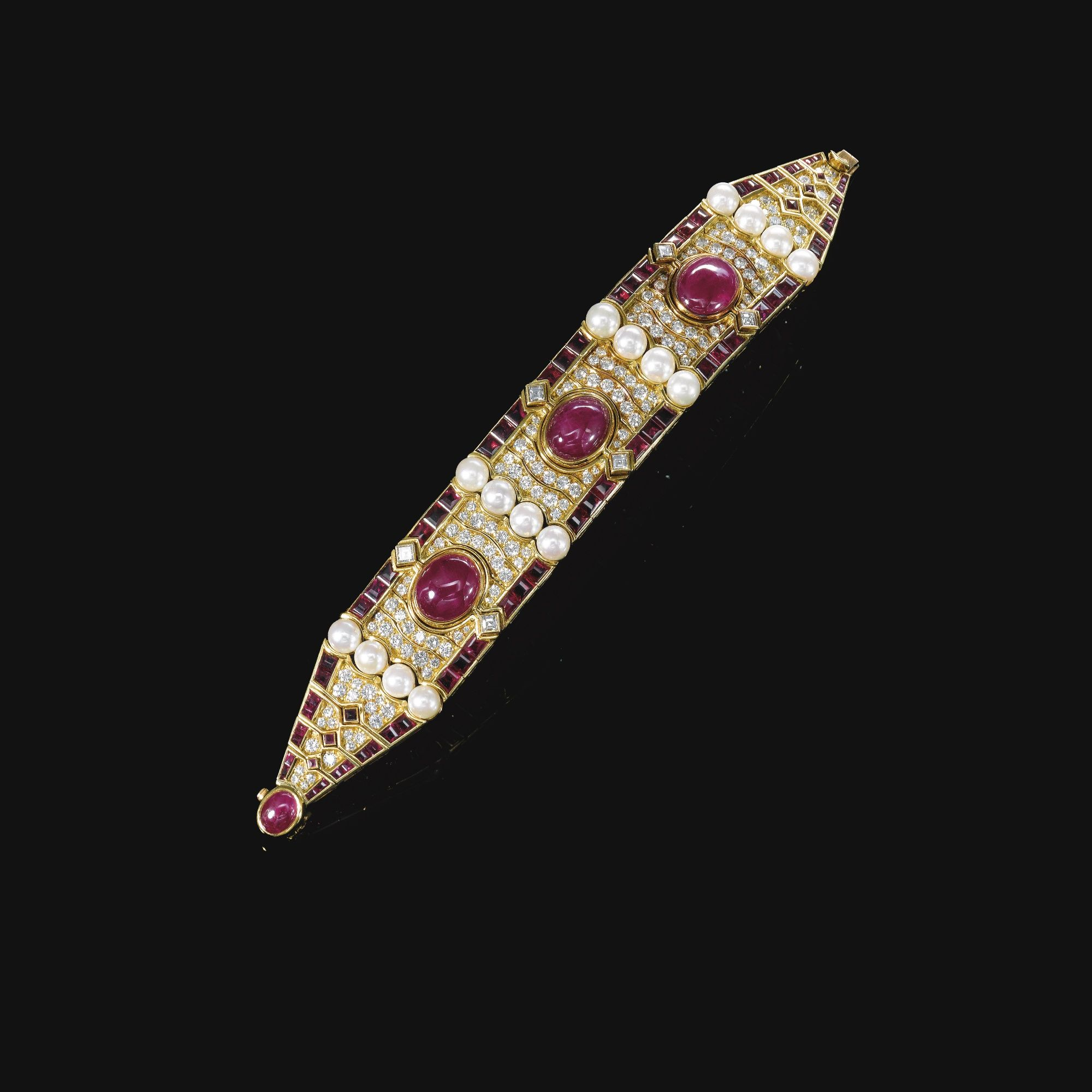 Cultured pearl, ruby and diamond bracelet, Bulgari, 1980s The front set with three oval cabochon rubies, surrounded with undulating lines of brilliant-cut diamonds, framed at either side with calibré-cut rubies, and embellished with rows of cultured pearls, length approximately 177mm, signed Bulgari, Italian assay and maker's marks.