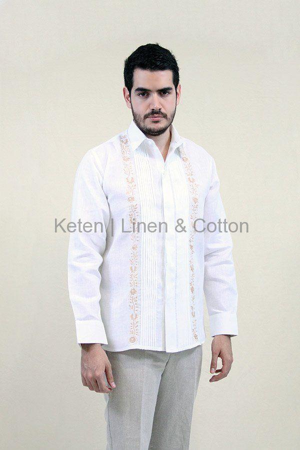 Camisa de Manga larga, hecha 100% de Lino color Blanco, con Alforzas en el frente, detalle de Bordado artesanal en Hilo de Seda color Caqui y botones ocultos.