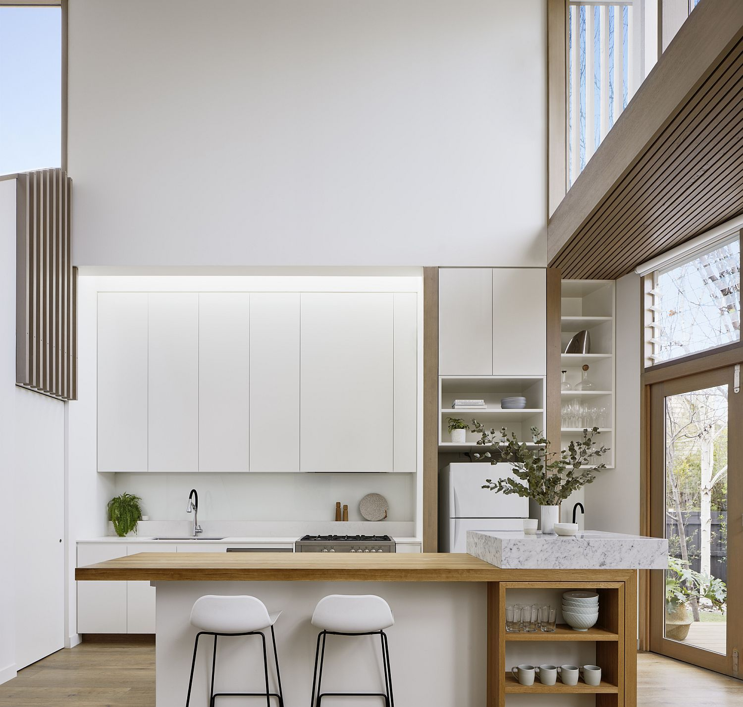 Double Height Modern Kitchen In White With Wooden Shelves
