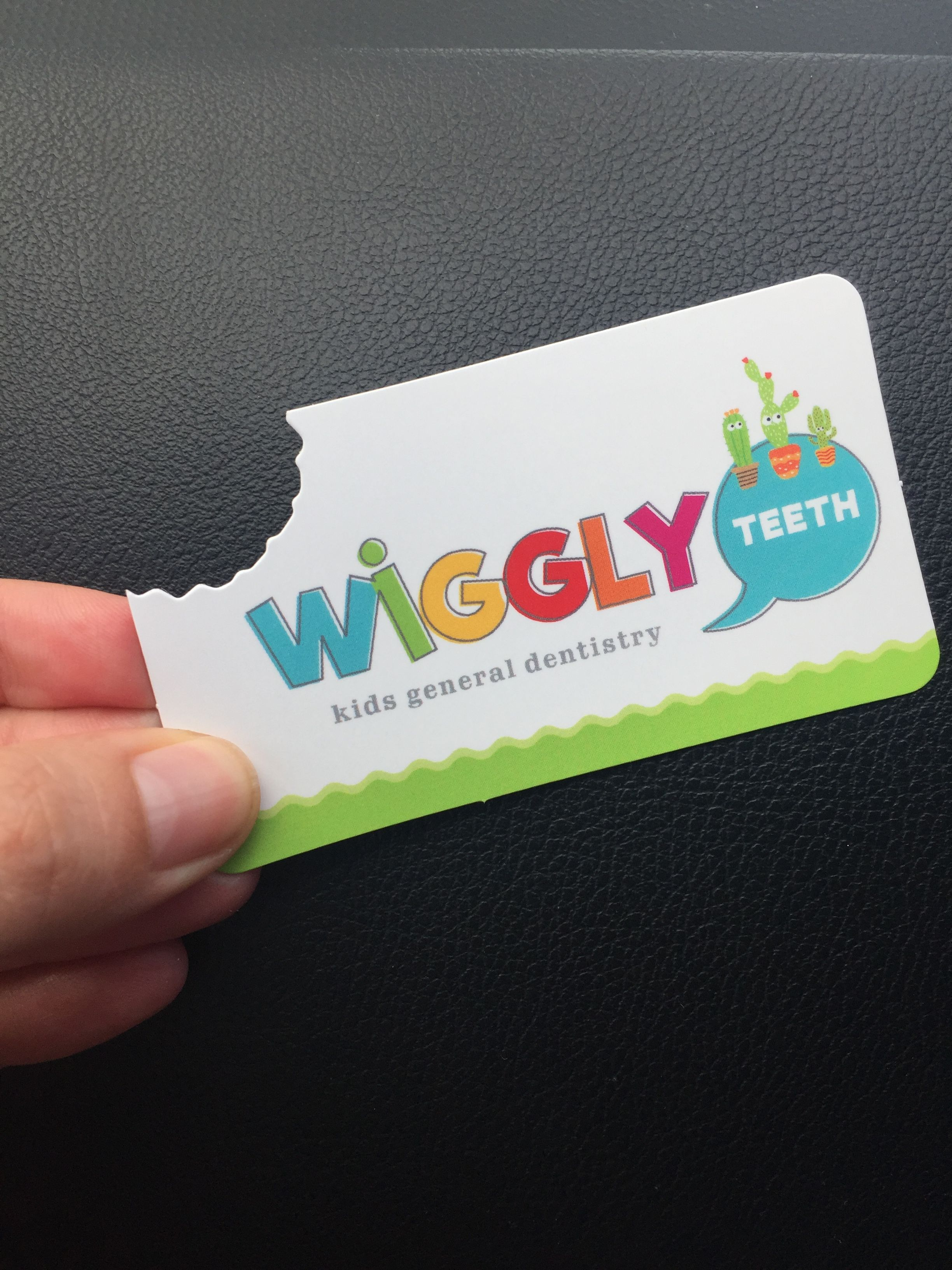 wiggly teeth dentist cut bite mark business card