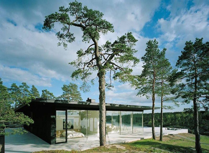 Villa Överby is a summer house with pure forms and clean lines. The design of the house followsunadorned lines to highlight the lightness and beauty of simplicity. Lots of open social space combining the kitchen, dining and sitting room areas maximize the views through the glazed walls facing the sea. The dark black roofing and exterior walls create a massive contrast for the light parts of the house.Also point out the overflowpool on the outer edge of the terrace.The house is designed…