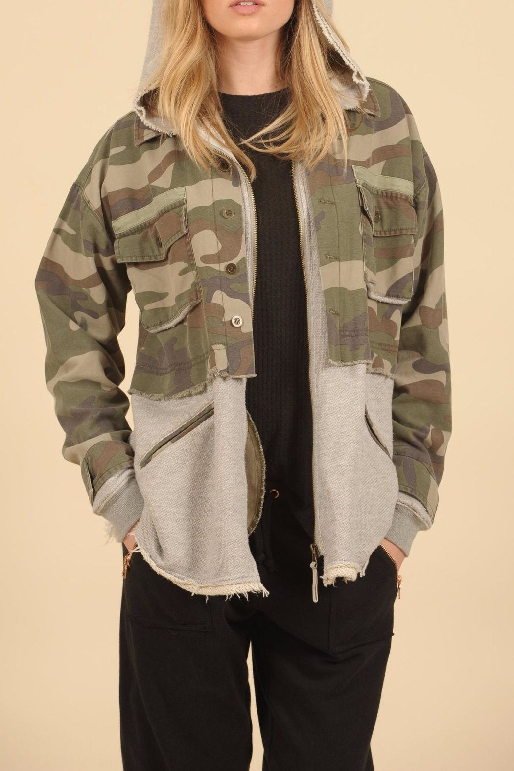 1f0848f99a644 Details include a gray sweat-shirt hoody, zip pockets, and adjustable  straps in the back. Army Camo Jacket by Vintage Havana.