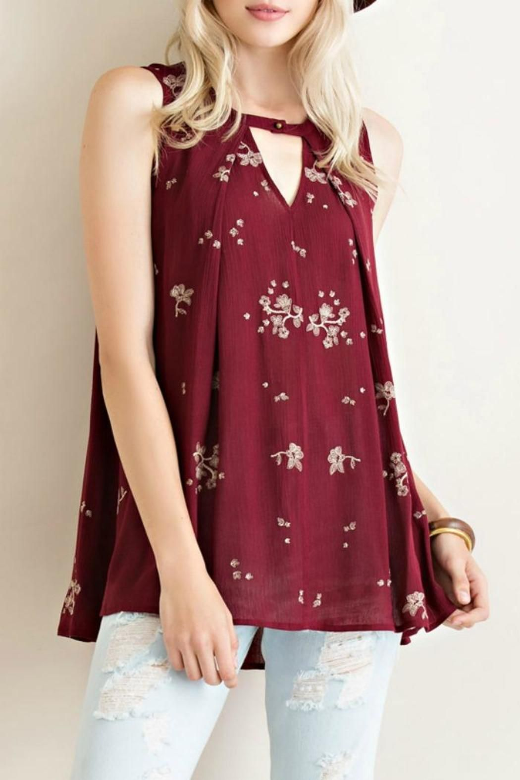 This top features a keyhole neckline a sleeveless sleeve and embroidered flowers throughout. Care instructions: dry clean only do not bleach hang to dry.  Falling Into Place Tank by Entro. Clothing - Tops - Sleeveless Mississippi