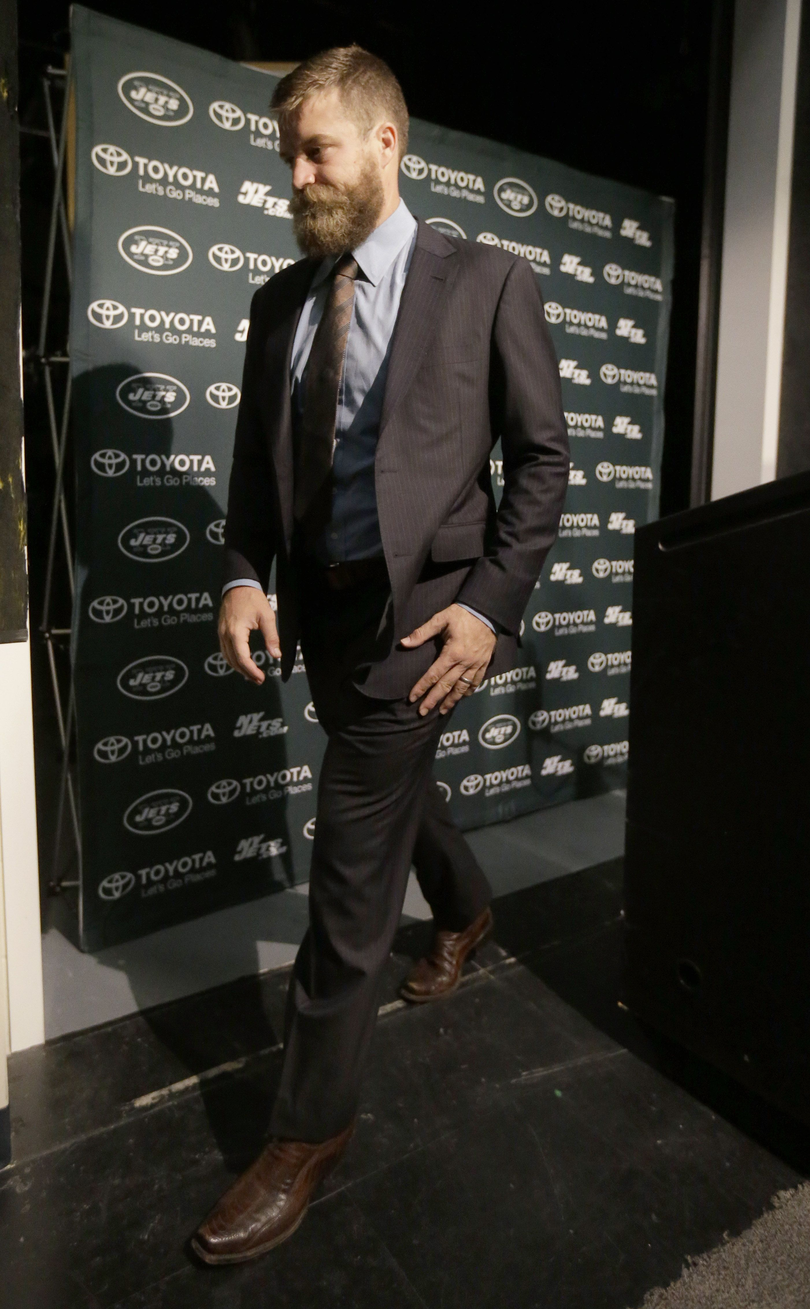 New York Jets quarterback Ryan Fitzpatrick leaves the traditional black or  navy suit at home ab9cce706