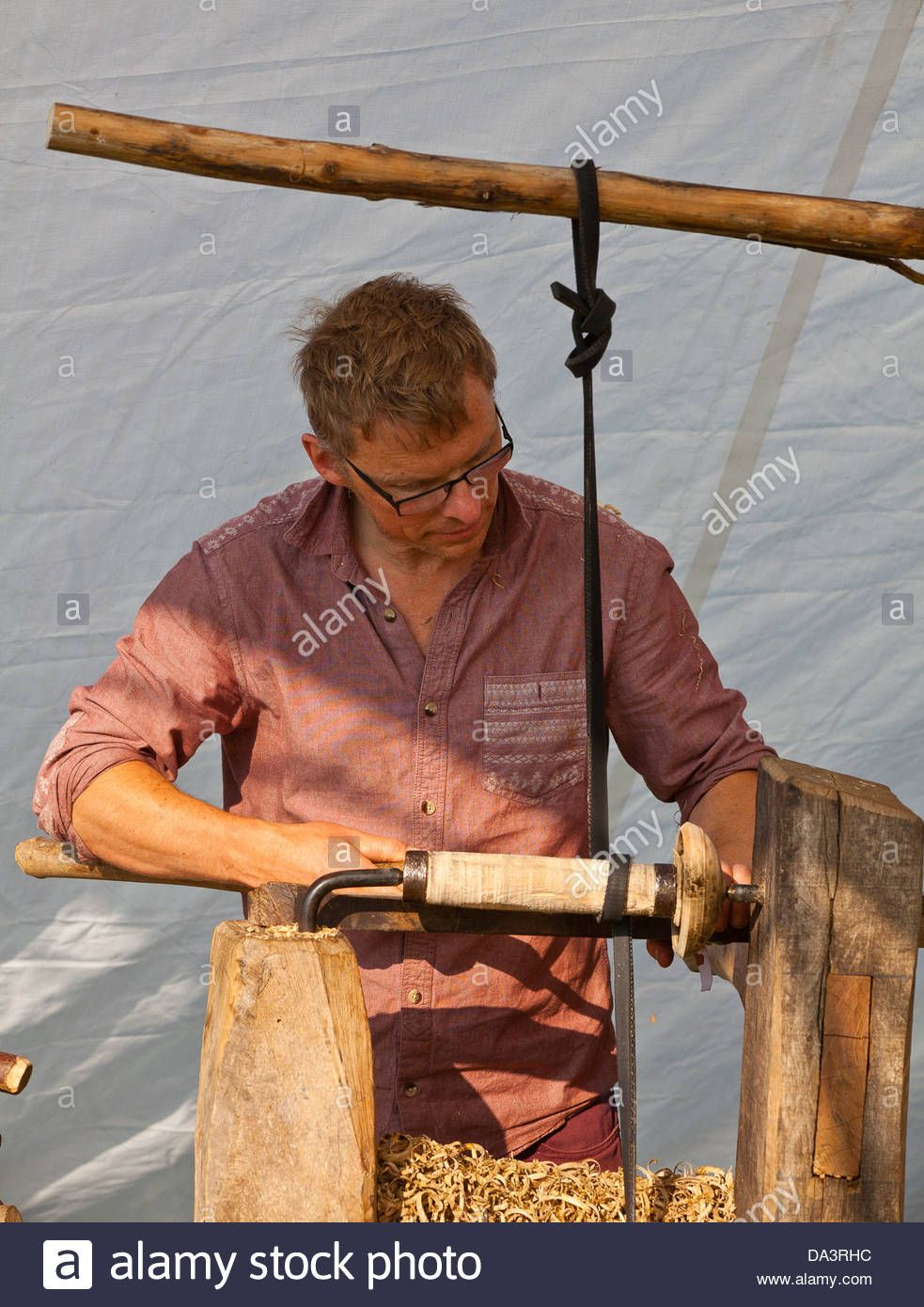 A man wood turning at Glastonbury Festival of Contemporary
