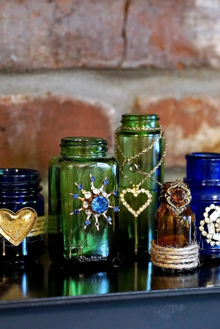 How To Decorate Glass Bottles And Jars With Jewelry is part of Glass bottles decoration, Recycled glass bottles, Bottles decoration, Bottle crafts, Diy bottle, Bottles and jars - It's easy to decorate glass jars with jewelry  I used colorful jars I picked up here and there and jewelry pieces from my junk stash to make the tiny vases