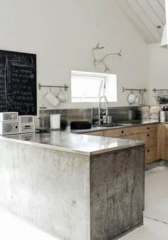 amazing nordic kitchen design in concrete and wood  rustic wood kitchen - white floors - no uppers - chalkboard - stainless steel counter