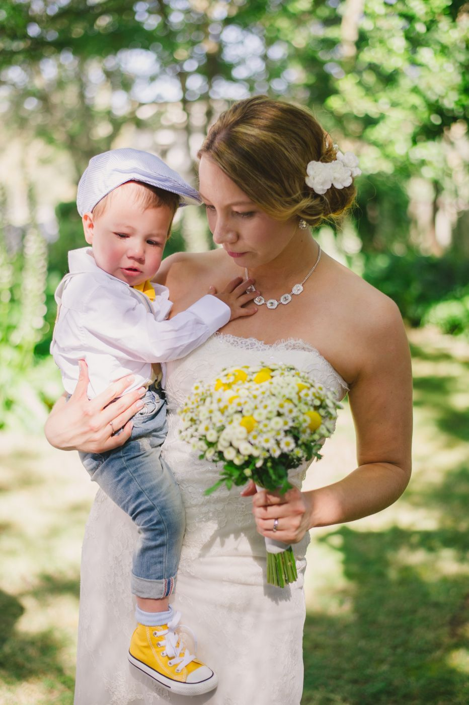Bride with baby son dressed in clothes with yellow details ...