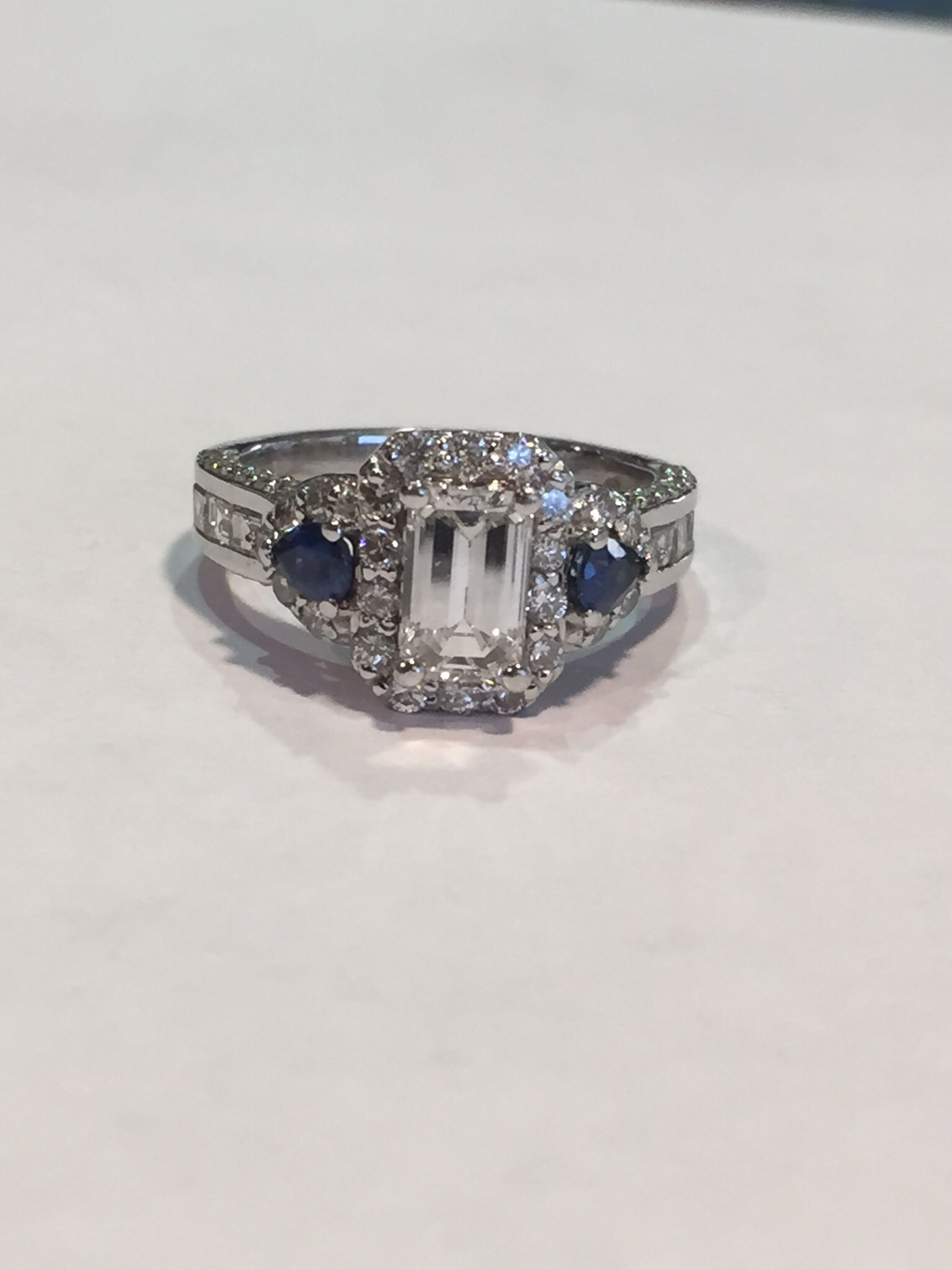 Halo Settings Added Around Center Emerald Cut Diamond And Tear Drop