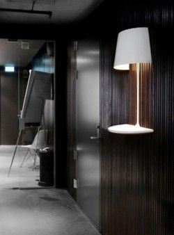 twigandsparrow:    The Illusion Lamp  A wall lamp and table in one