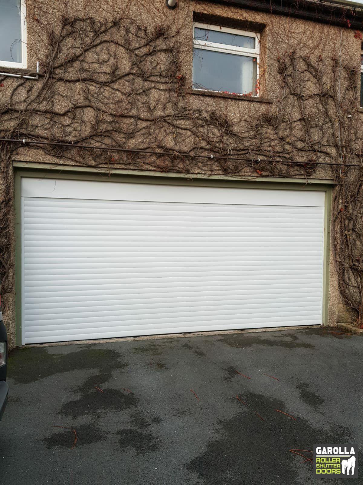 Electric Garage Door In Blueelectric Garage Door In Blue Blue Door Electric Garage Singlegaragedoorwide In 2020 Garage Doors Overhead Garage Door Garage Door Design