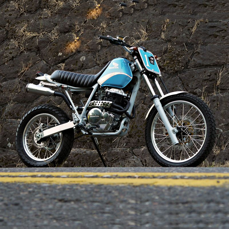 The Honda XR650L is one of those big, bulletproof dual sport bikes that never seem to change. It's tough and simple to fix, just like its evergreen competitors—the Suzuki DR650 and the Kawasaki KLR650. With a 21-inch front wheel and a 37-inch seat height, the XR650L is not exactly custom-friendly. So this retro-inspired revamp from Joe Tessitore of Digital Directiv is a welcome oddity.