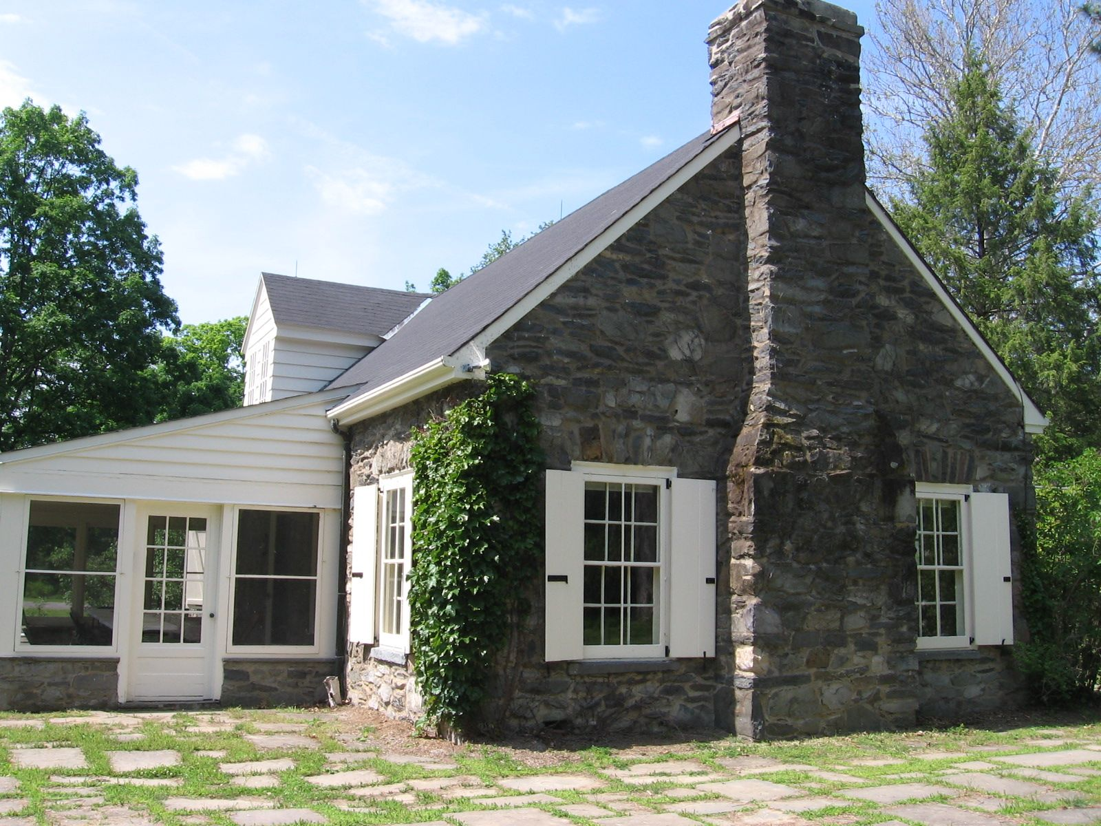 Modern Stone Cottage love the white trim and shutters against the gray stone   charming