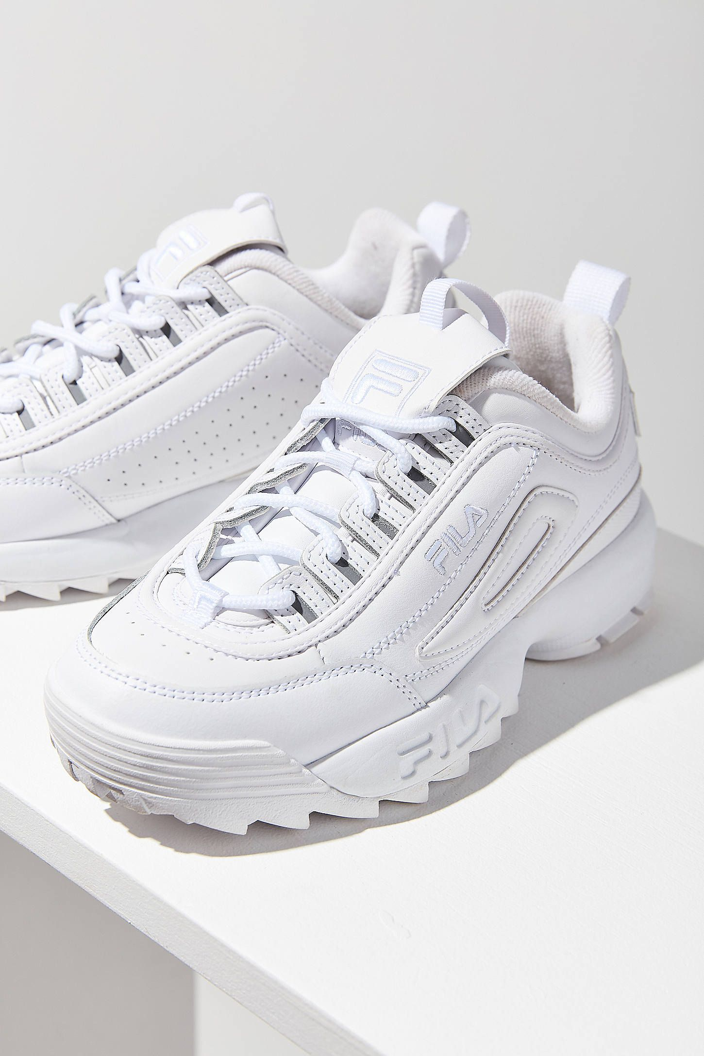 8818d86c34a0 Shop FILA Disruptor II Premium Mono Sneaker at Urban Outfitters today. We  carry all the latest styles